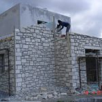 Exterior Stonewalls' Construction with Insulation Inbetween