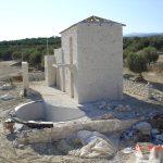 Stone walls of villa Nefeli